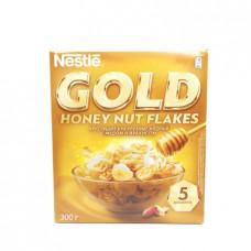 Сухой завтрак Nestle Gold хлопья кукурузные с медом и арахисом, 300г
